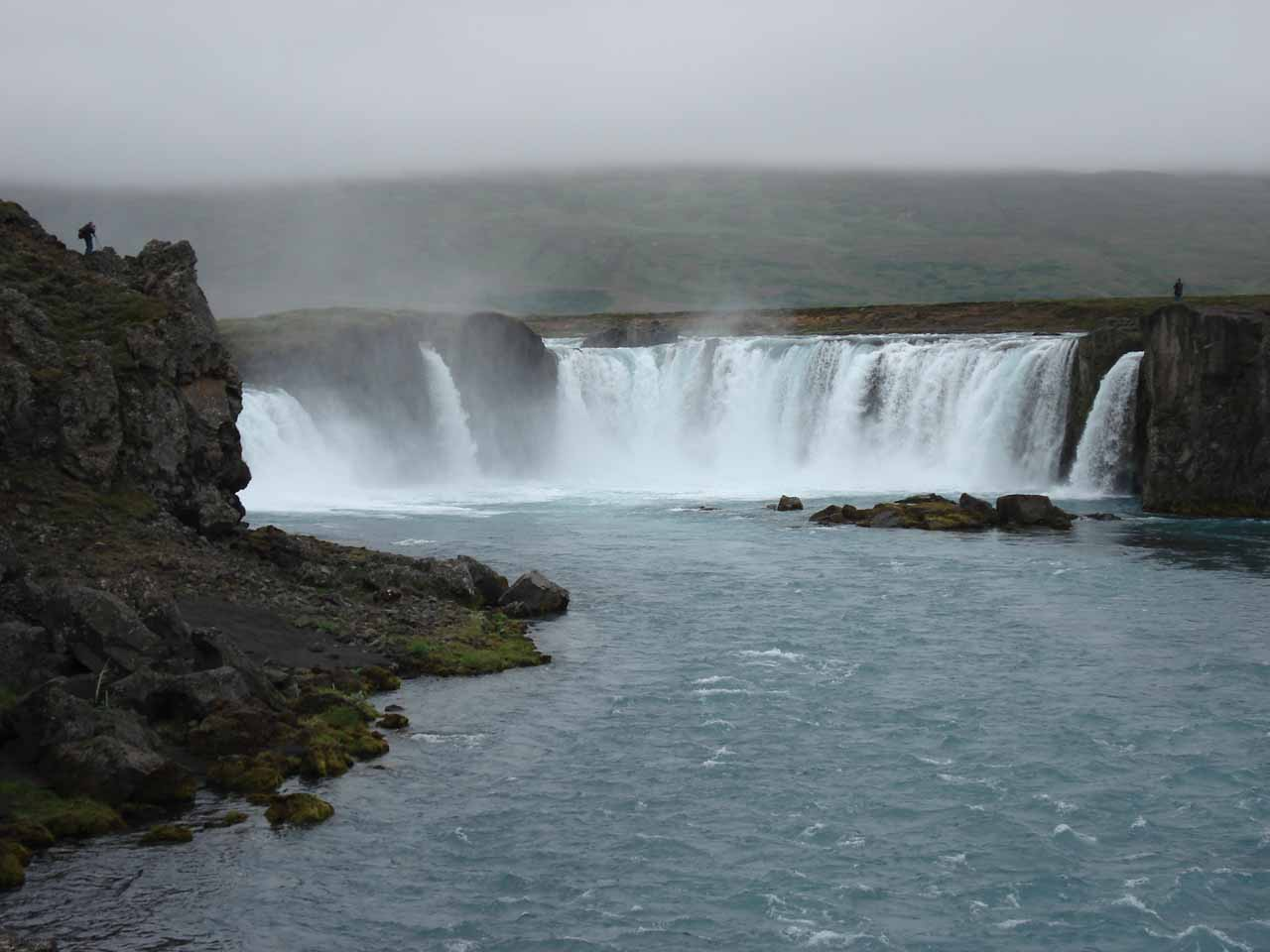 Approaching Goðafoss with some people standing on atop each bank of the river giving us ideas on where we ought to check out the falls