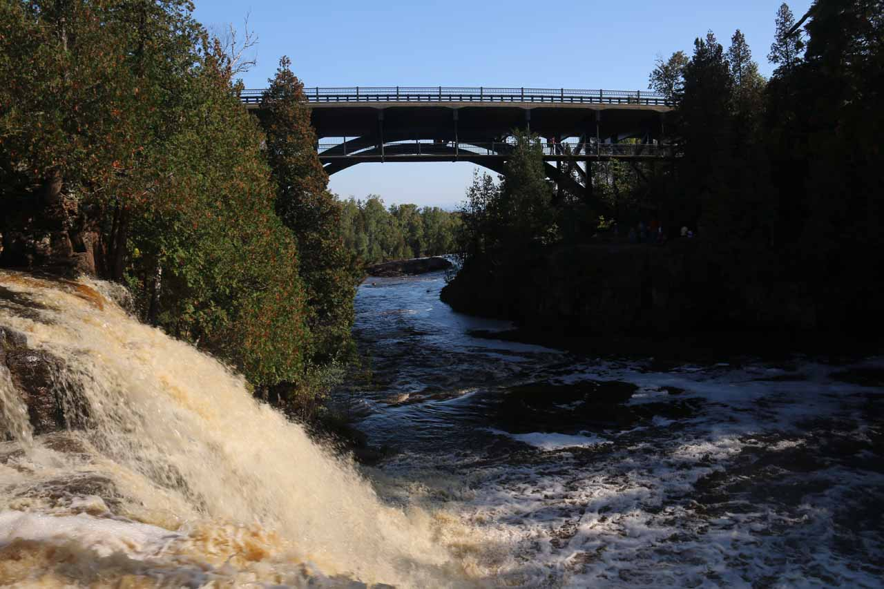 Looking across the brink of Upper Gooseberry Falls towards the Hwy 61 road bridge