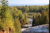 Gooseberry_Falls_052_09272015 - Looking downstream over the brinks of the Middle and Lower Falls as the Gooseberry River meandered towards Lake Superior in the distance