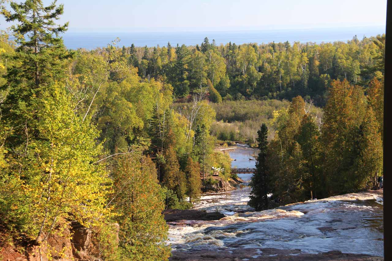 Looking downstream over the brinks of the Middle and Lower Falls as the Gooseberry River meandered towards Lake Superior in the distance