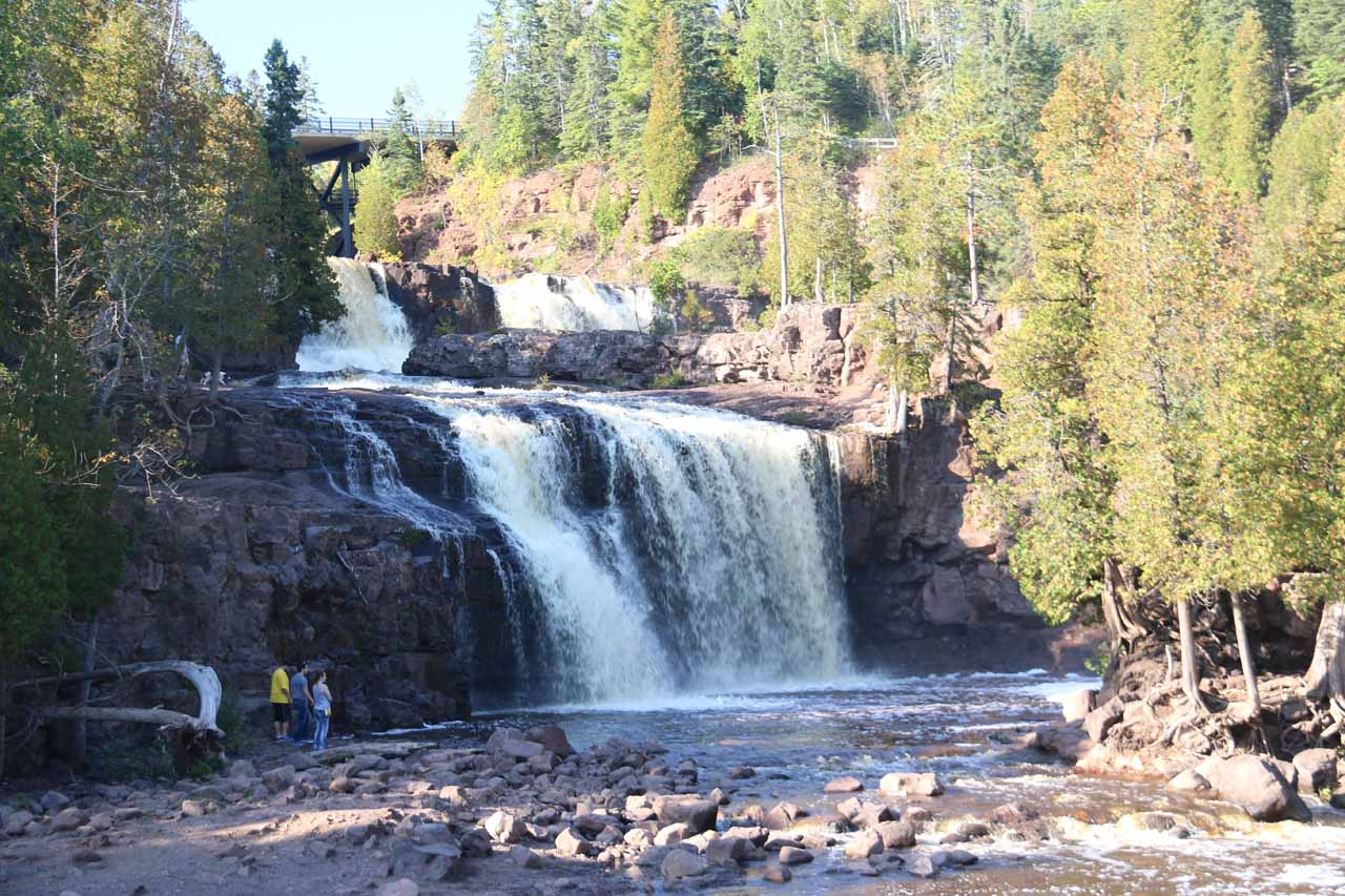 Here's a more focused look at the Middle and Lower Gooseberry Falls with some people by its base for a sense of scale