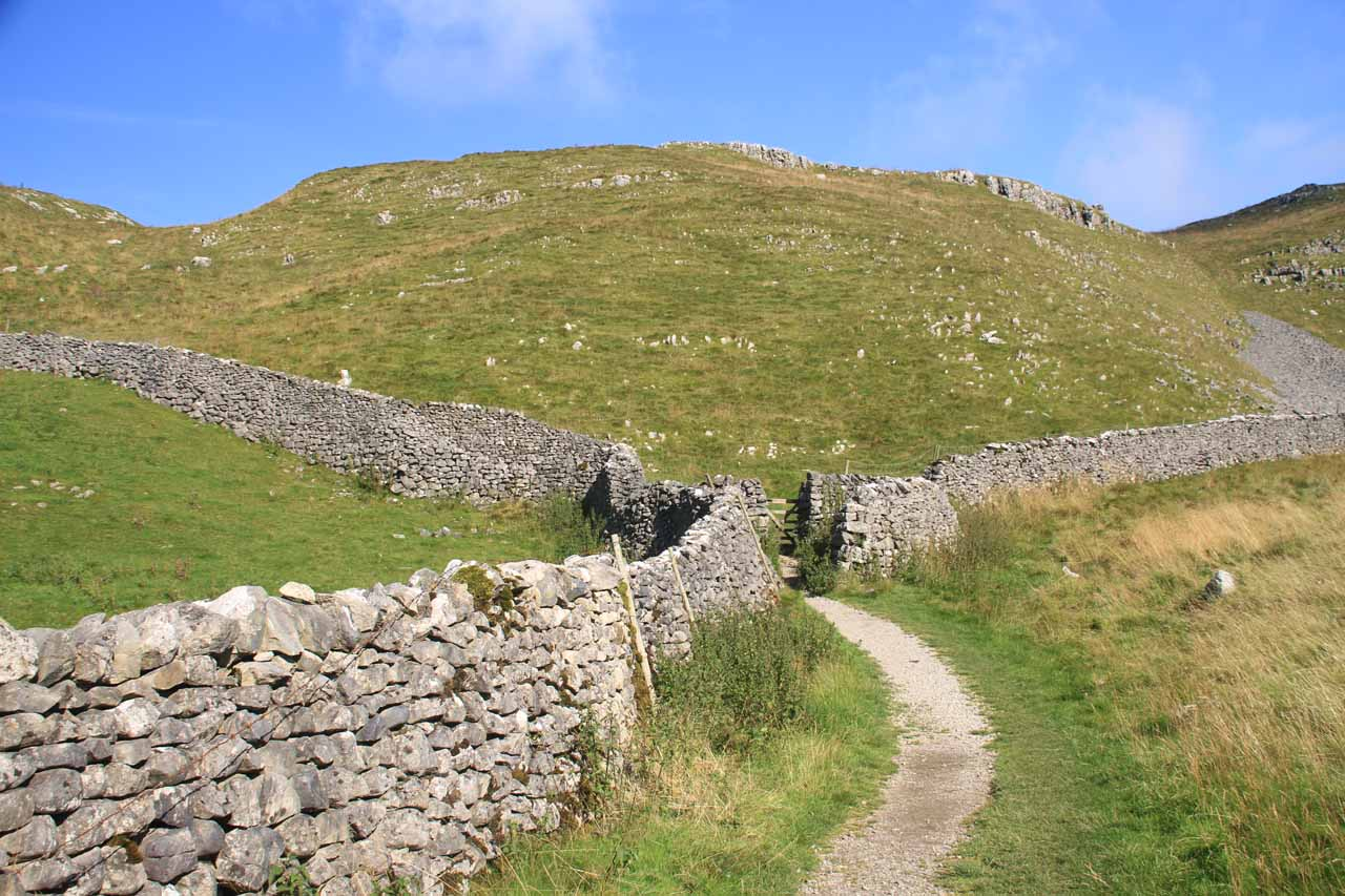 Continuing on the trail to Malham Cove where I followed along these sheep walls amongst fields full of sheep, sheep dung, grass, and rocks