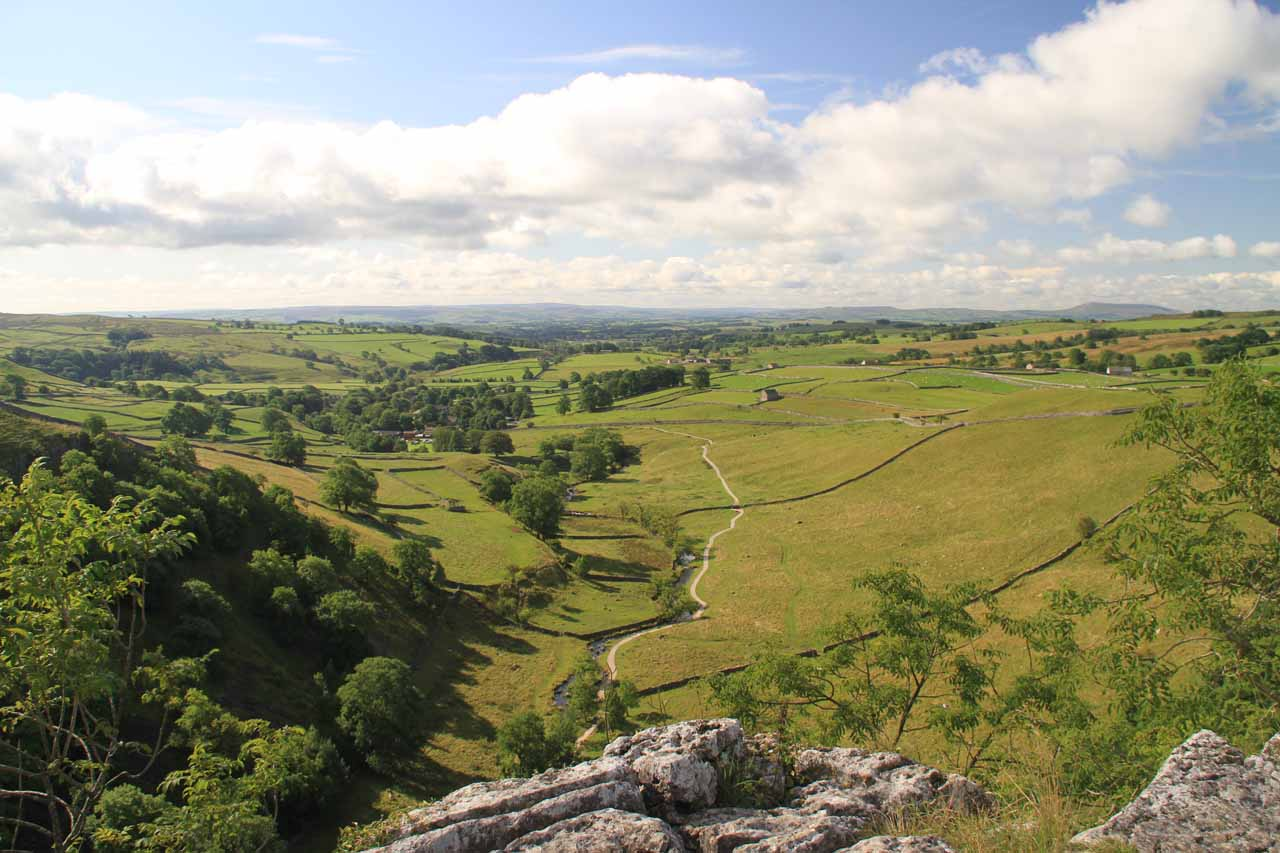 Looking out past the Malham Cove towards the pastures downstream of the Malham Beck