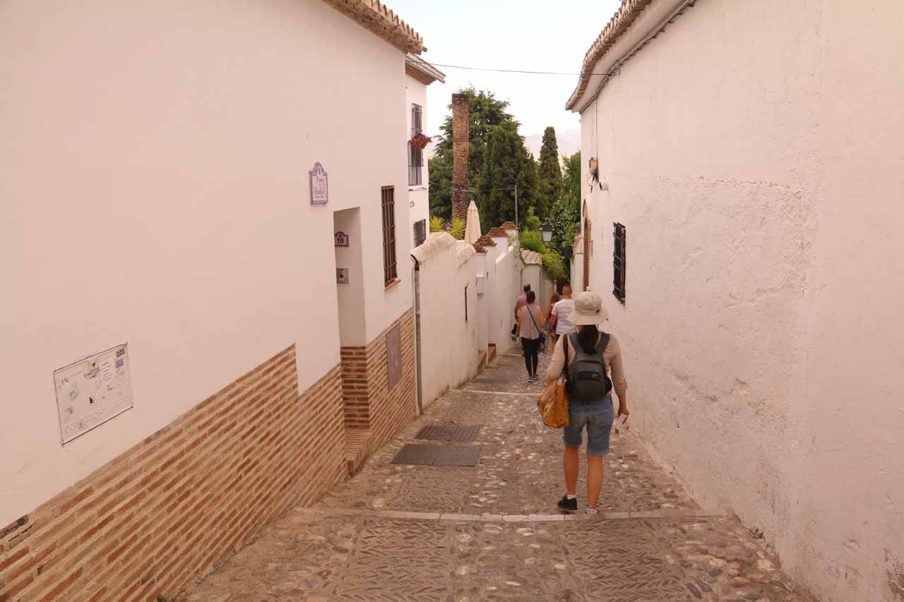 Julie going through a narrow alleyway as we continued the descent in the Albaicin neighborhood