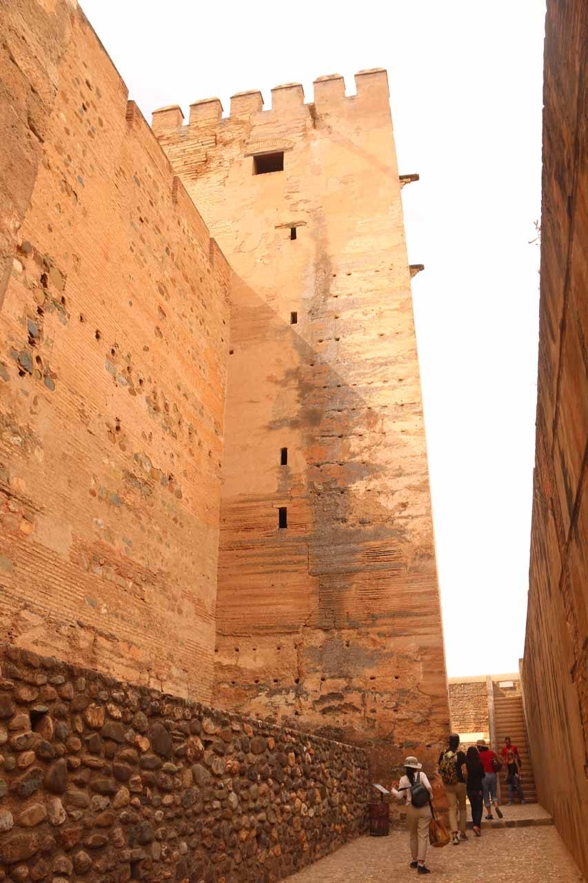 Walking alongside some very tall and imposing walls of the Alcazaba