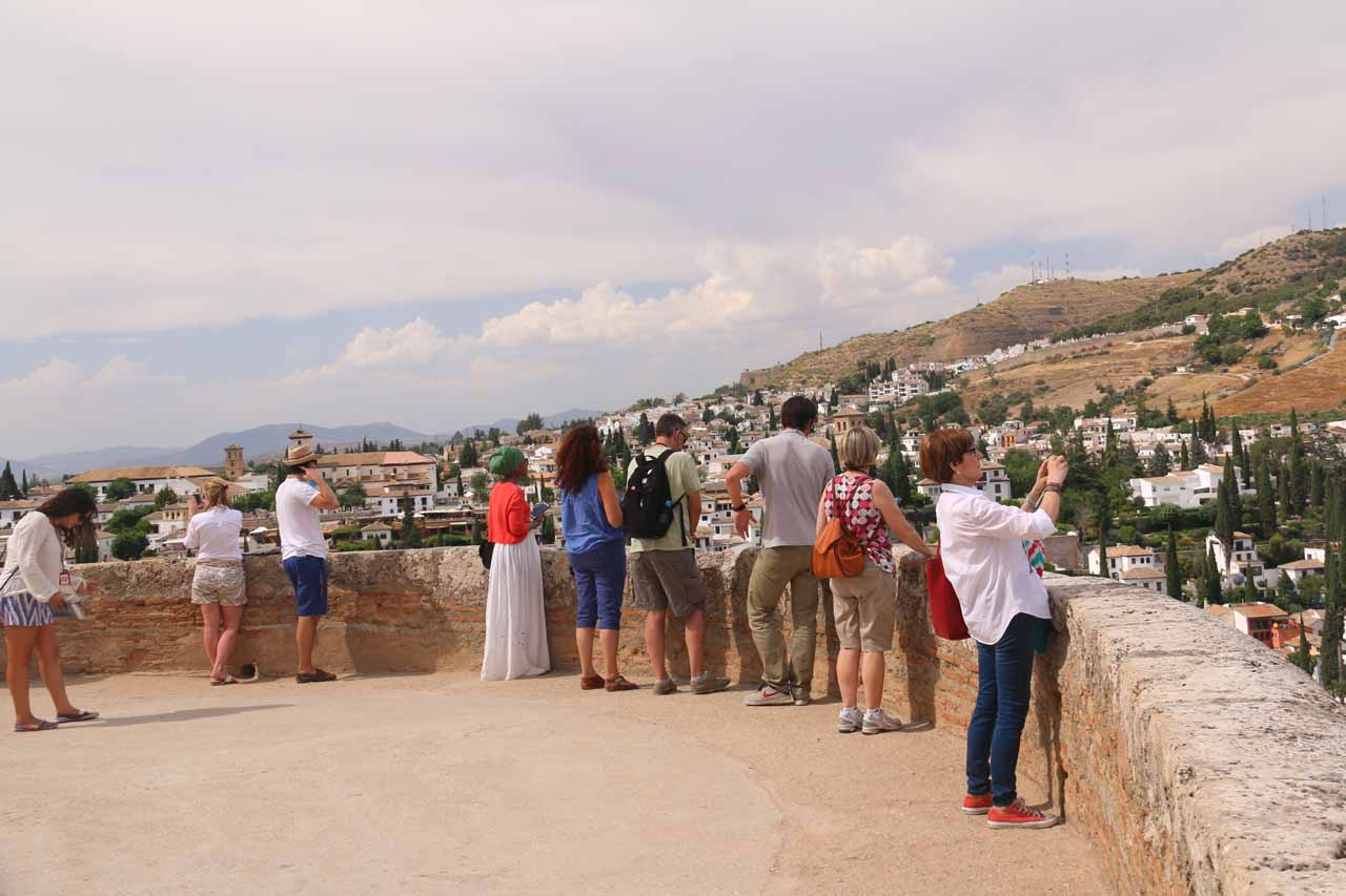 A lot of people enjoying the panoramic views from the Alcazaba