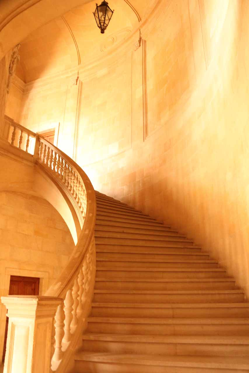 Going up the steps in the Palace of Charles V