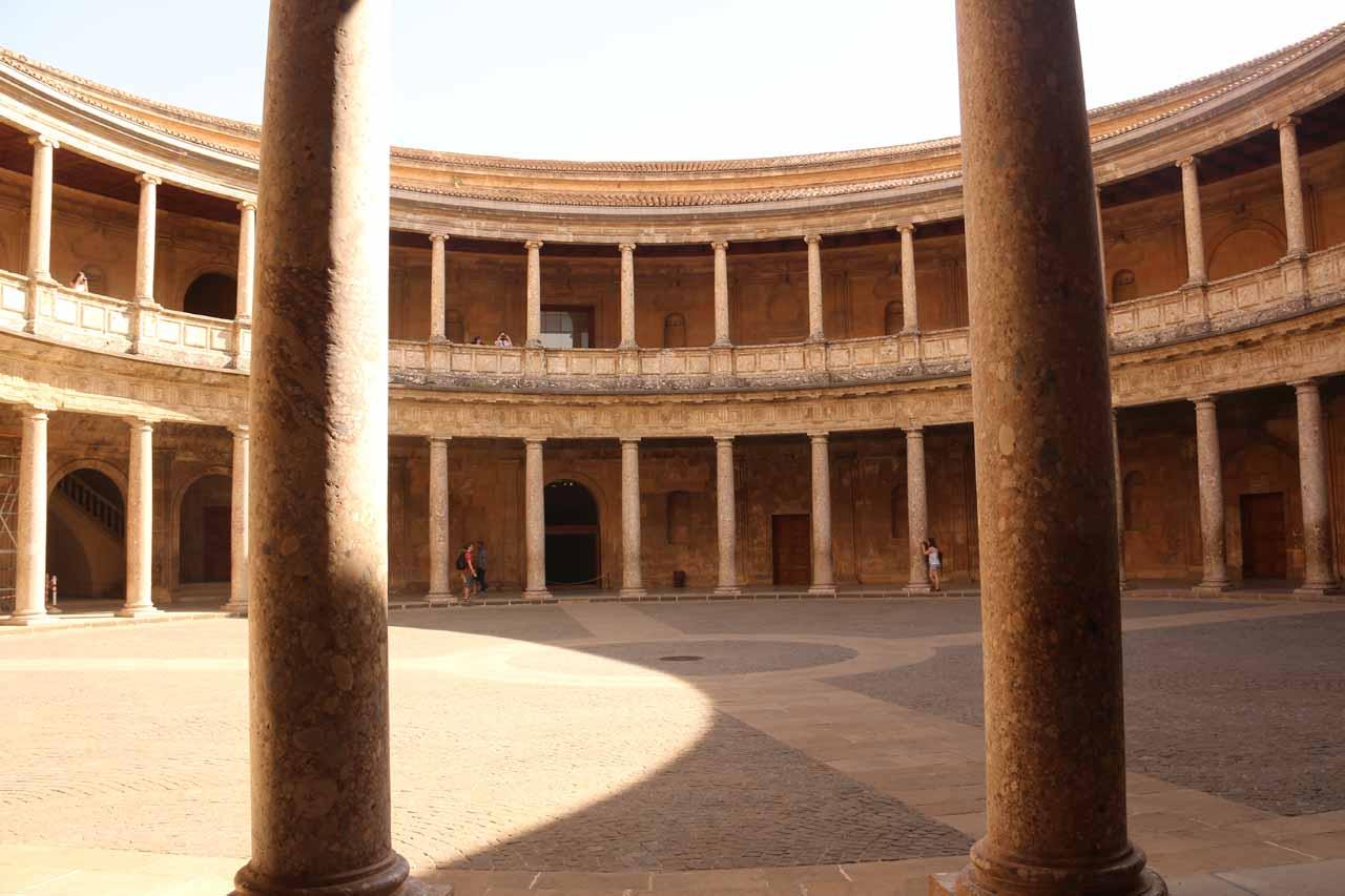 Looking between columns towards the circular open area at Palacio de Carlos V