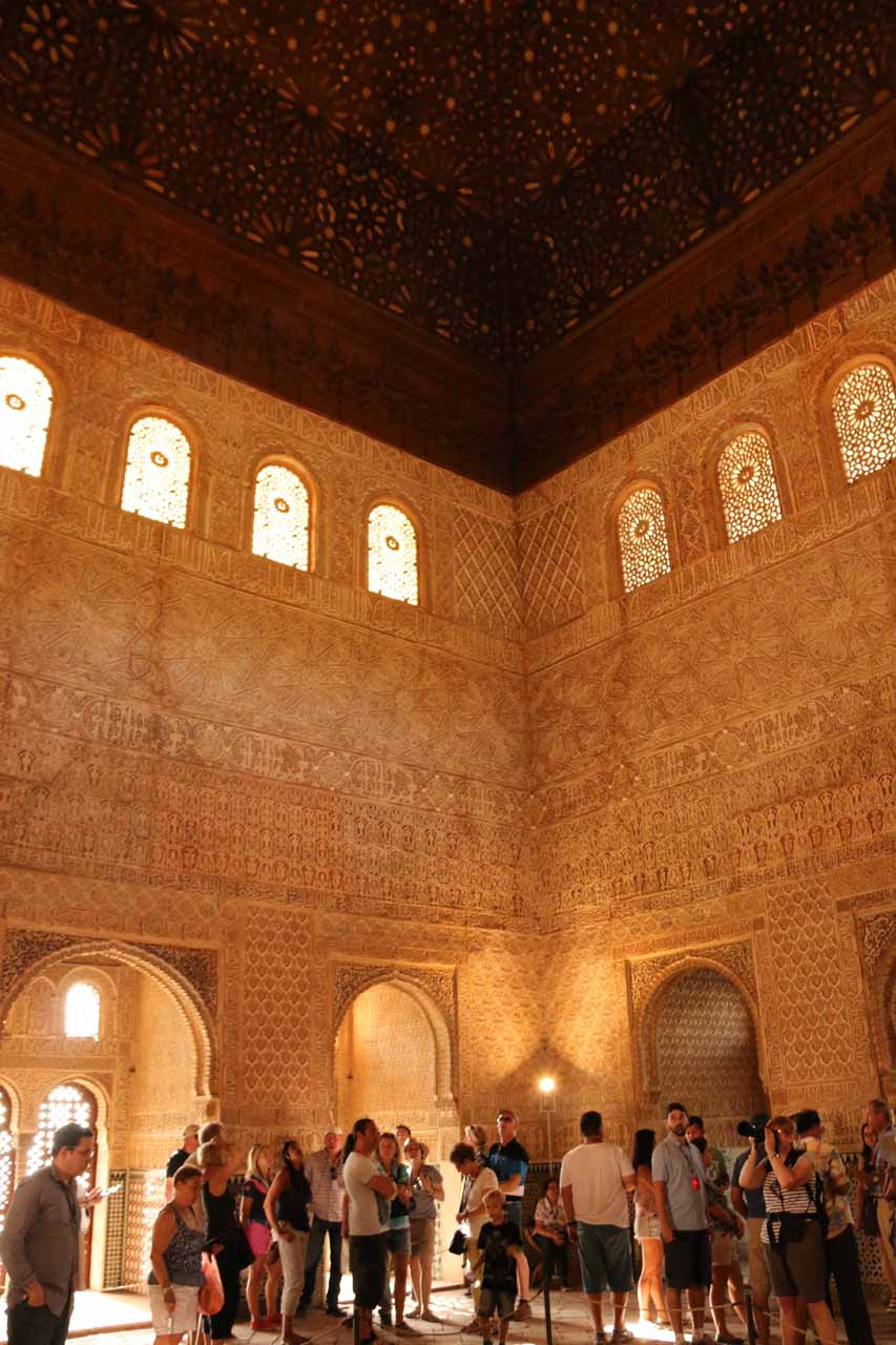 A beautiful room in the Palacios Nazaries featuring stars up top and many adornments and patterns all around us
