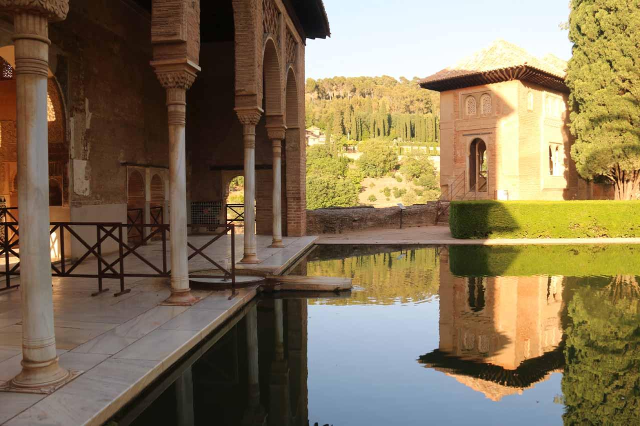 Calm reflective pond before the Palacio del Partal