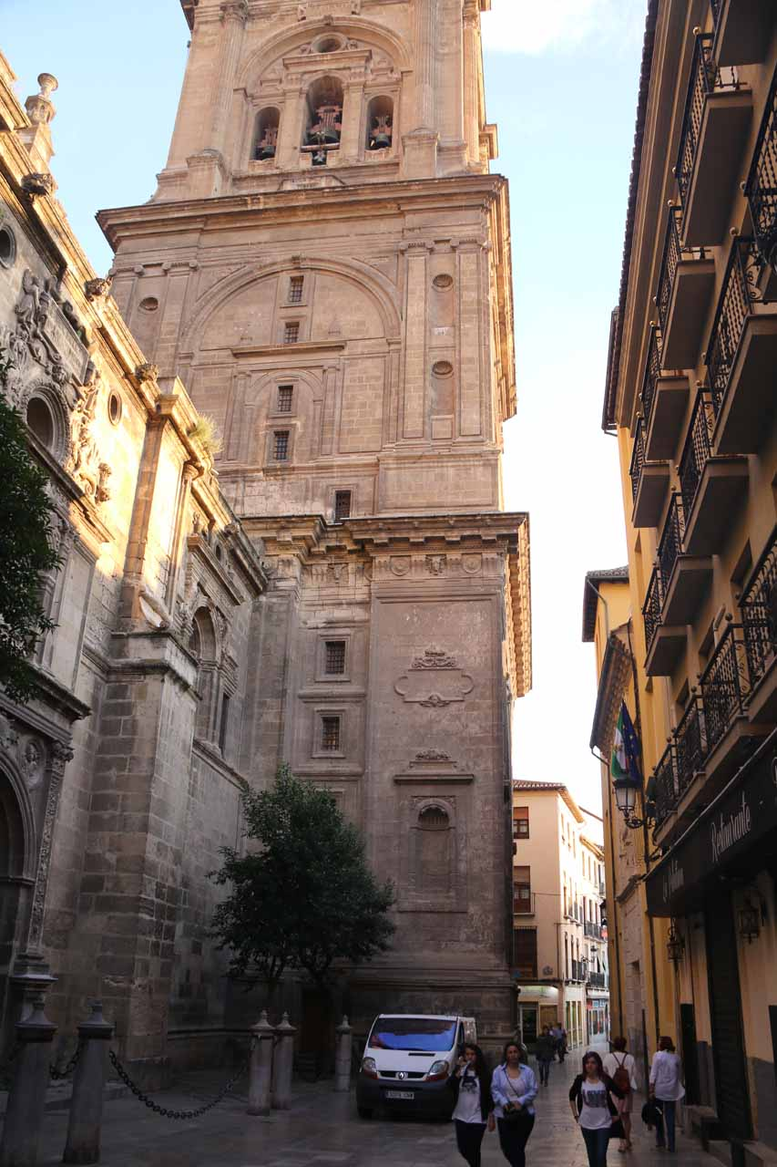 Walking by the side of the big cathedral in Granada near Bib Rambla