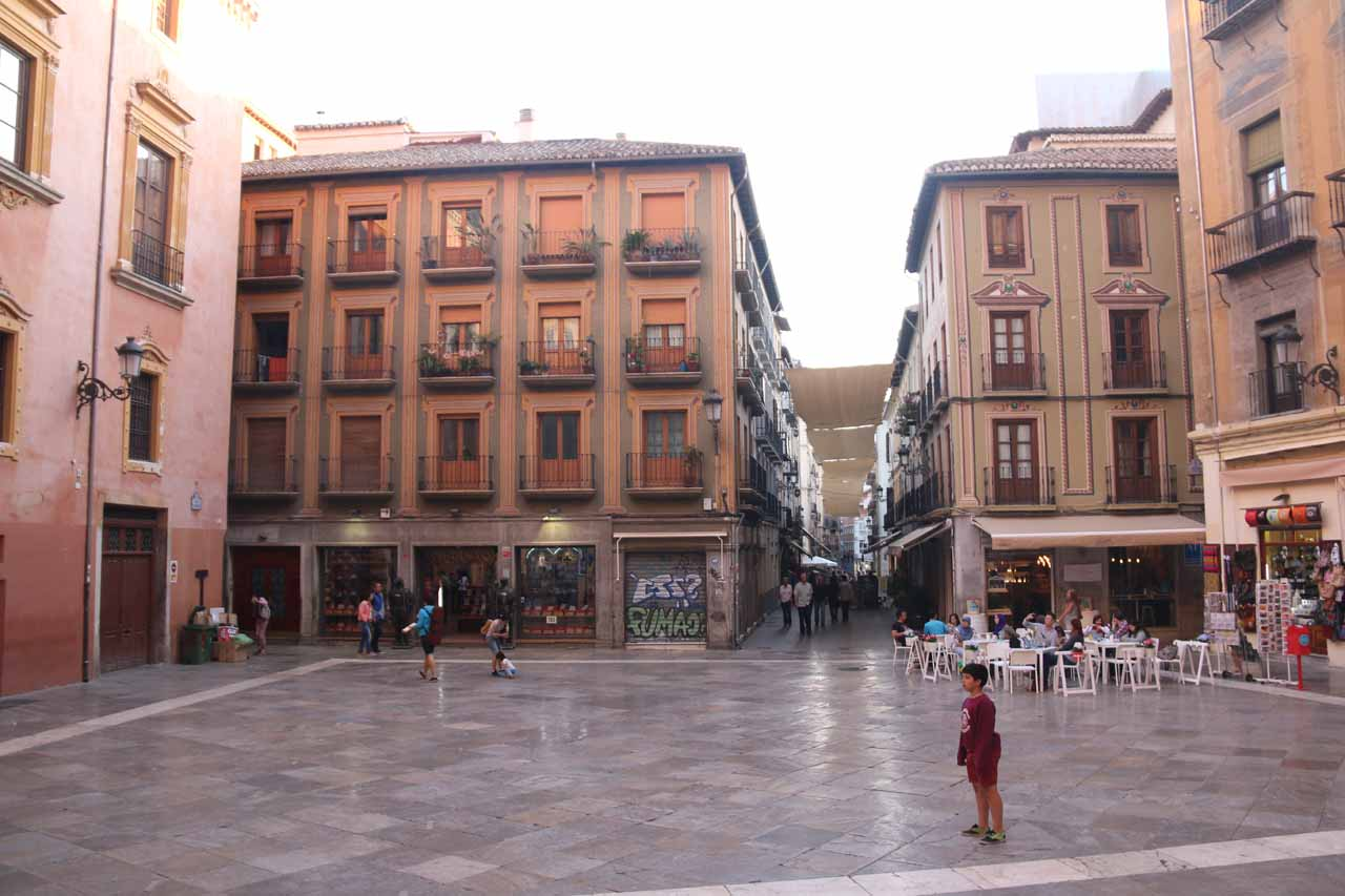 Looking back at the open but deceptively slippery square before the front facade of the Catedral de Granada