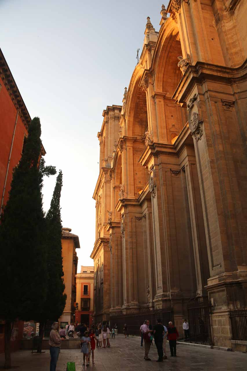 Sunset at the front facade of the grand cathedral of Granada