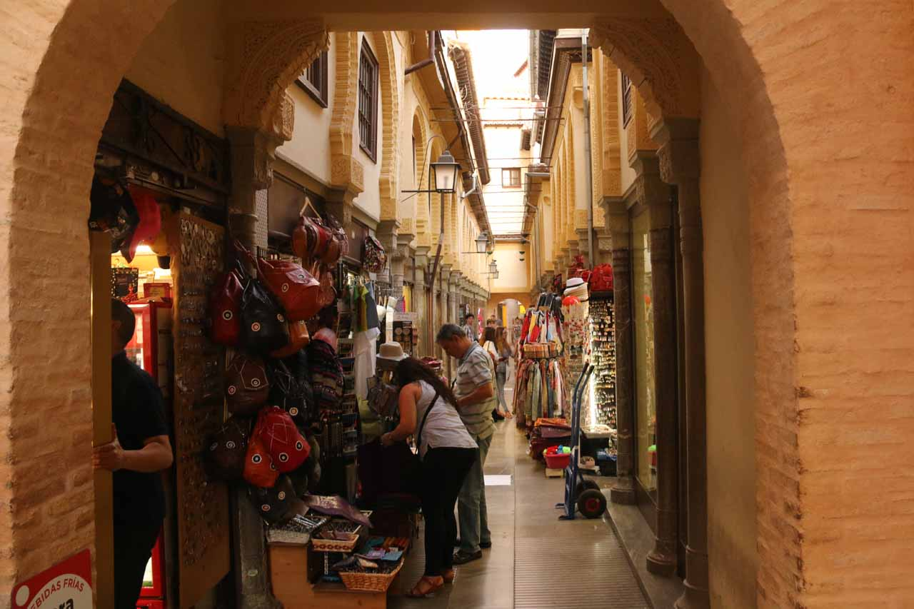 Looking inside one of the tight shopping arcades near the Catedral de Granada