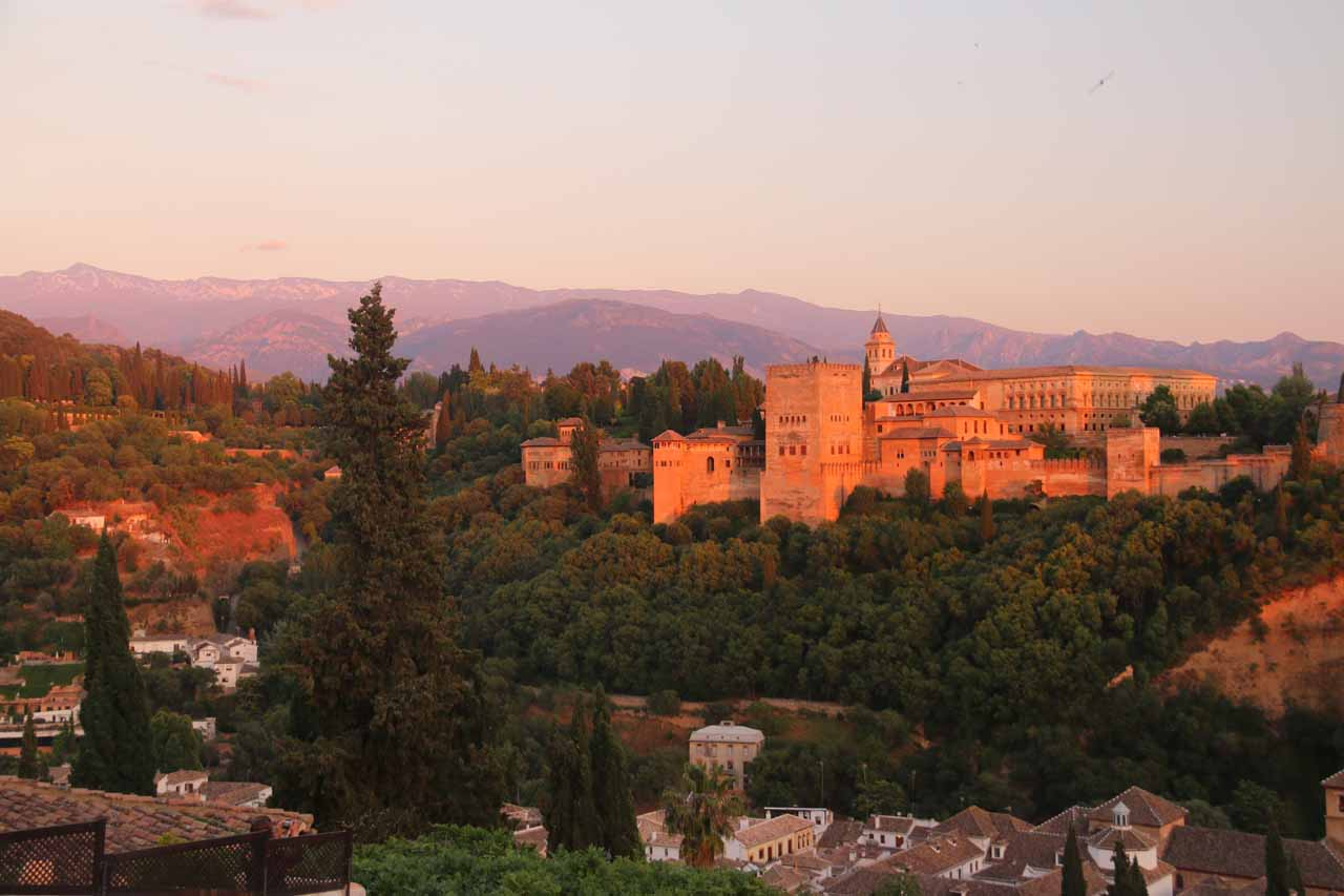 The Alhambra and the Sierra Nevada glowing deep orange as the sun was well on its way to setting; seen from Estrellas
