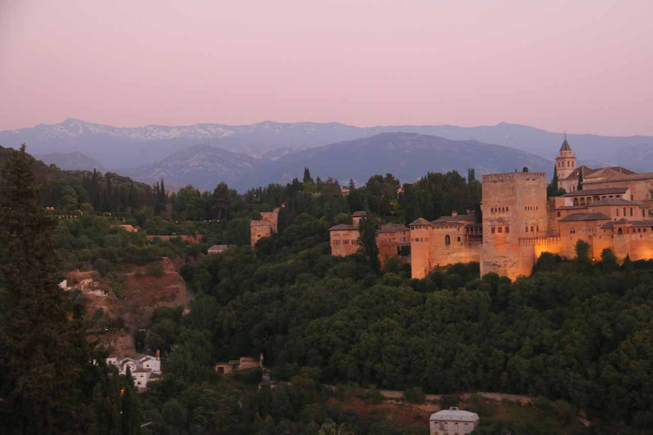 Twilight view of the Alhambra and the Sierra Nevada as the lights for the Alhambra were coming on