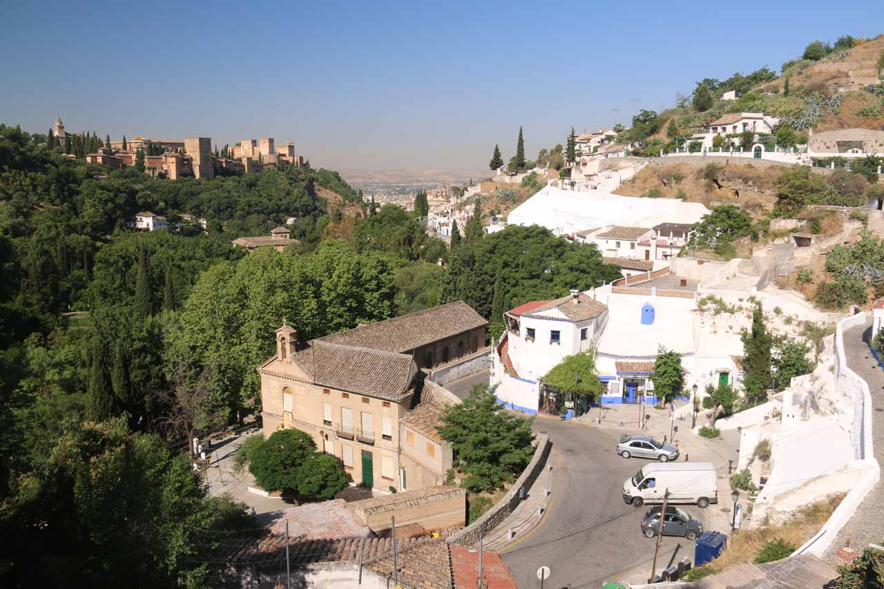Looking down over part of the neighborhood of Sacromonte with the Alhambra in the background