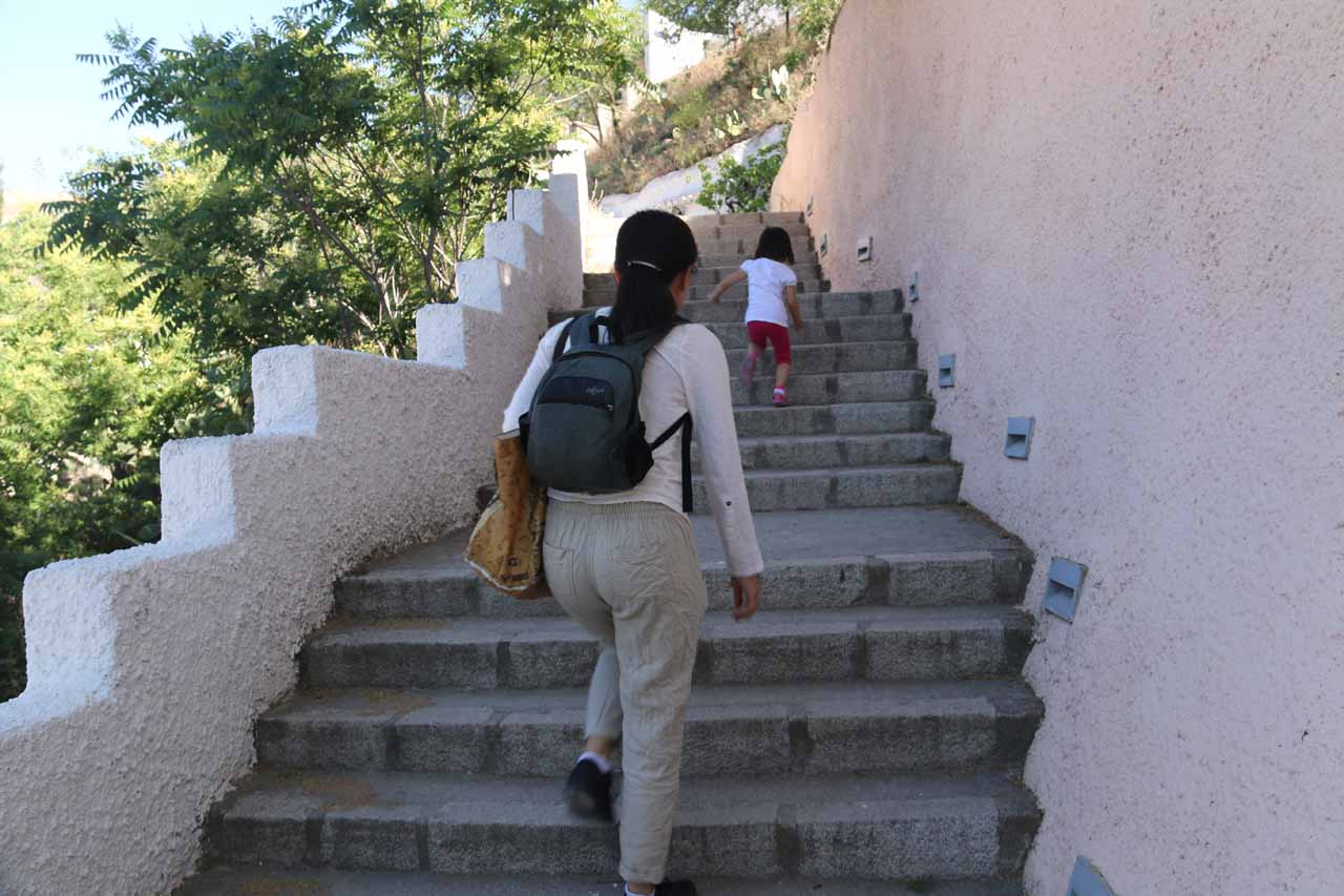 Tahia and Julie continuing to climb the steps to get up to the Museum of Caves