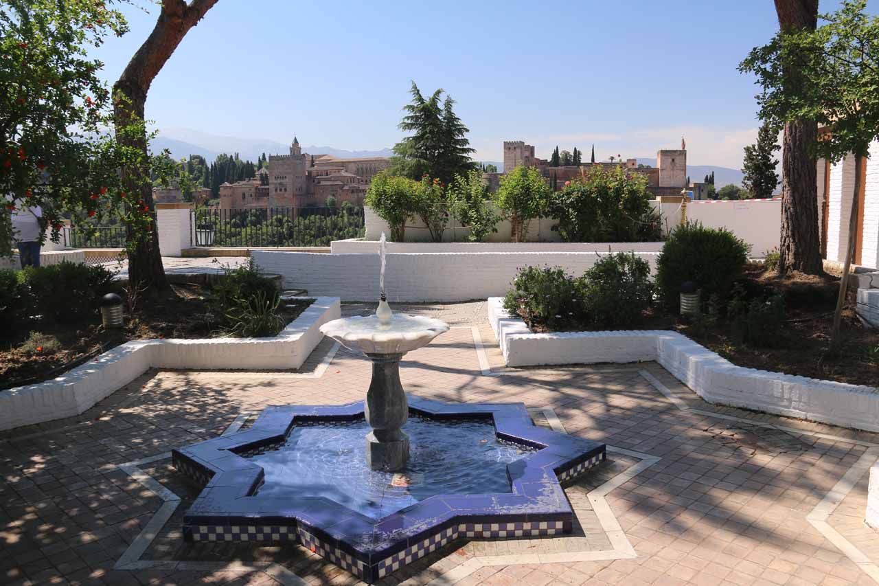 An Arabic fountain at the Grand Mosque fronting panoramas of the Alhambra in the distance