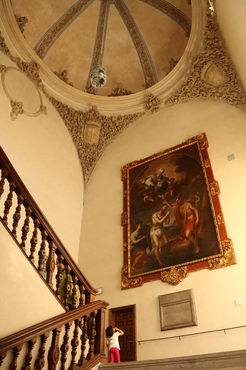 Tahia looking up at the 'bleeding guy' painting as we ascended the steps to go up to the knights room