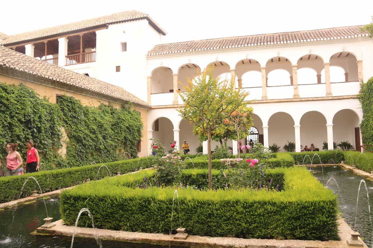 Looking back across another gardened courtyard towards the Palace of the Generalife