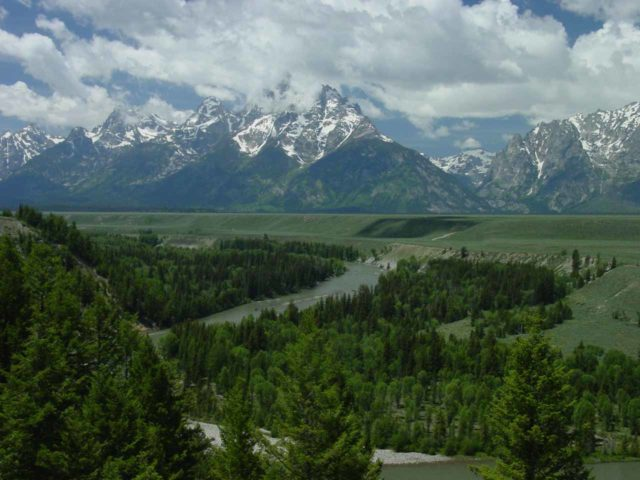 Grand_Tetons_072_06262004 - This was the Grand Teton Range at the famous Snake River Overlook were looking in the direction of Jenny Lake and Cascade Canyon. Over the years the trees below have grown to block parts of the river