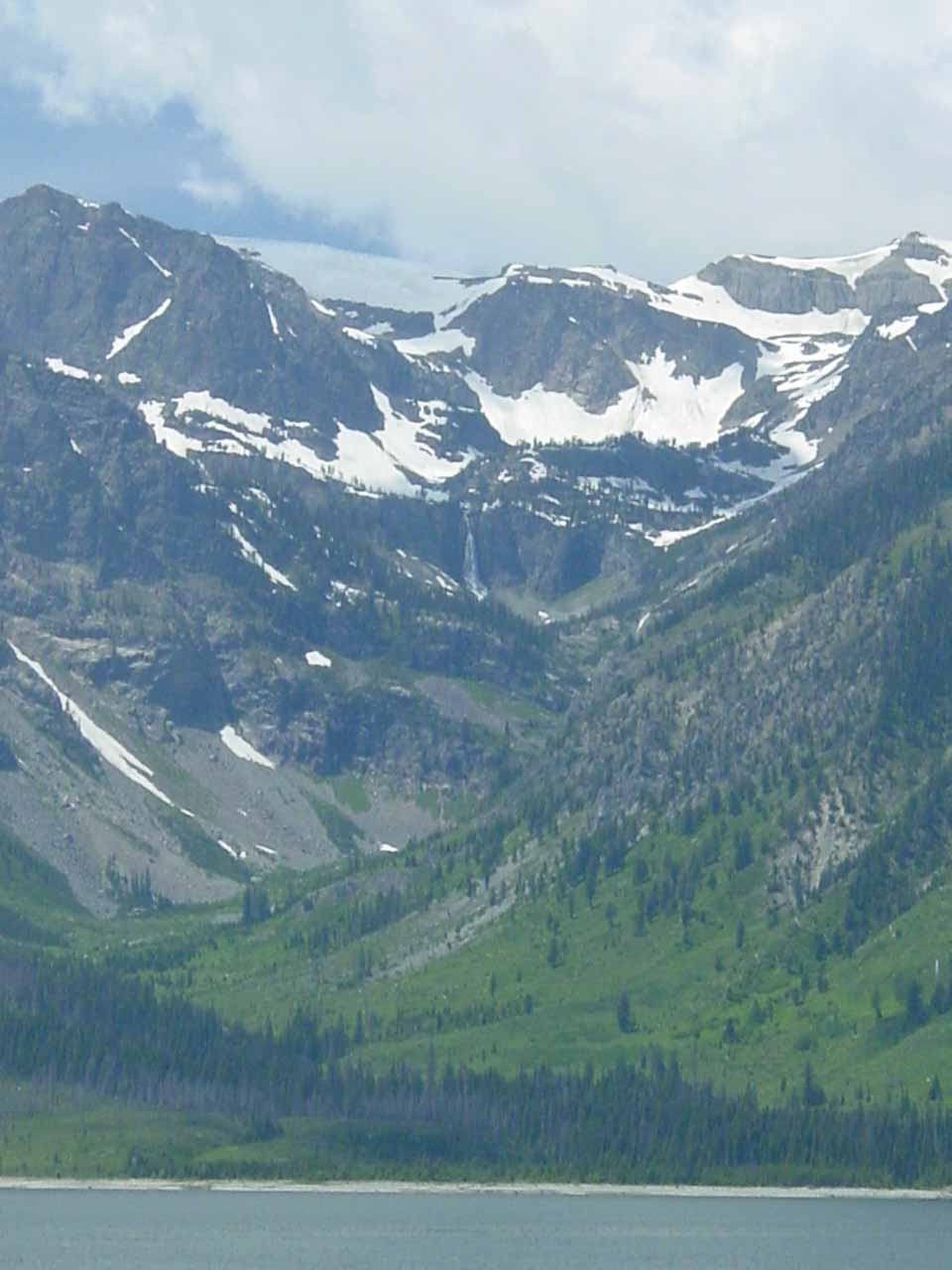 View of just Wilderness Falls from a different part of the Colter Bay complex with Jackson Lake in the foreground