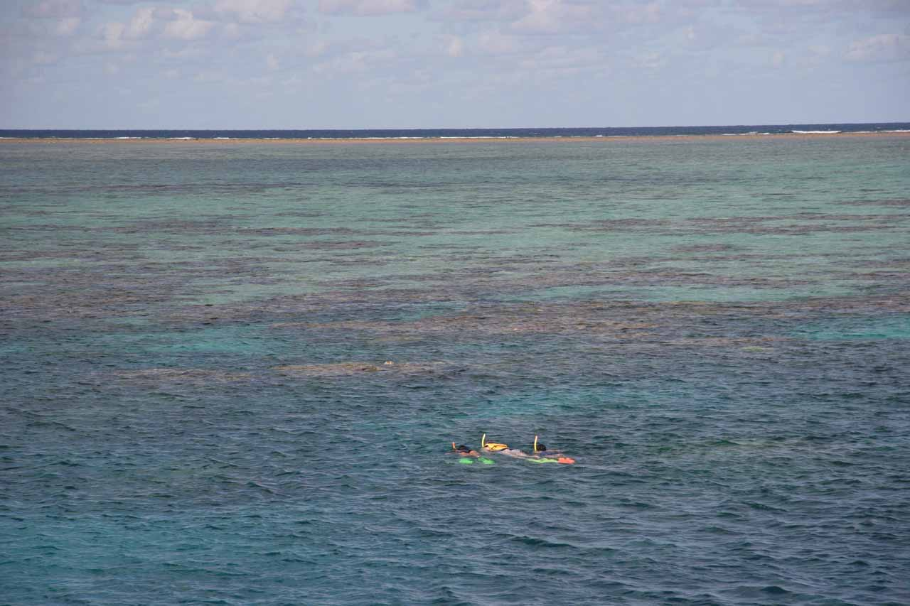 looking out at the Great Barrier Reef with a pair of snorkelers