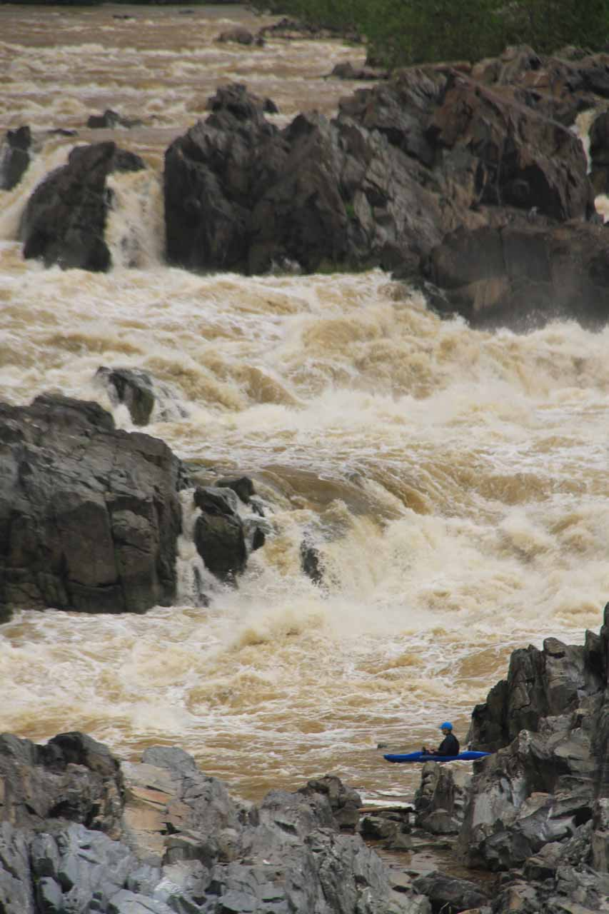 A kayaker making his way into the white water of Great Falls