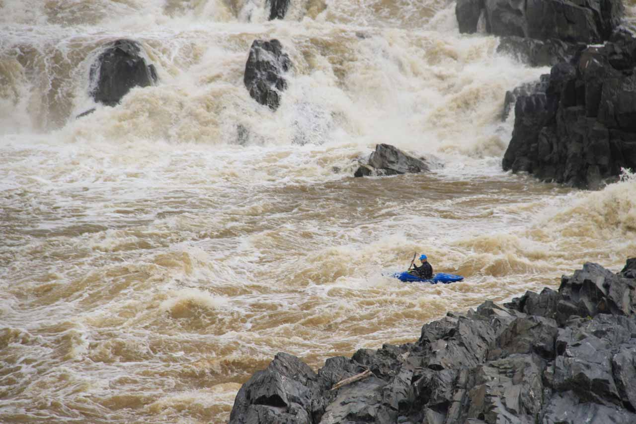 A kayaker navigating through the lowermost sections of the Great Falls of the Potomac