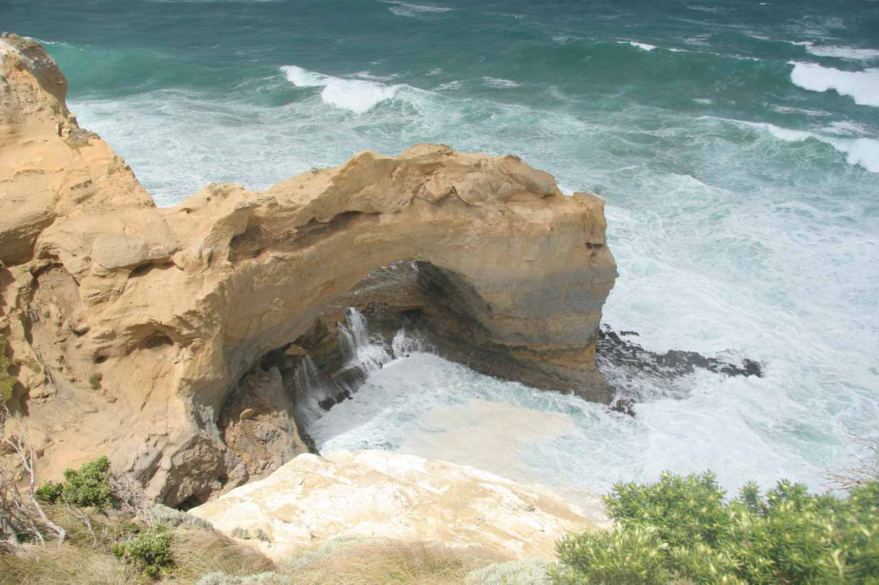 Looking down at a sea arch along the Great Ocean Road