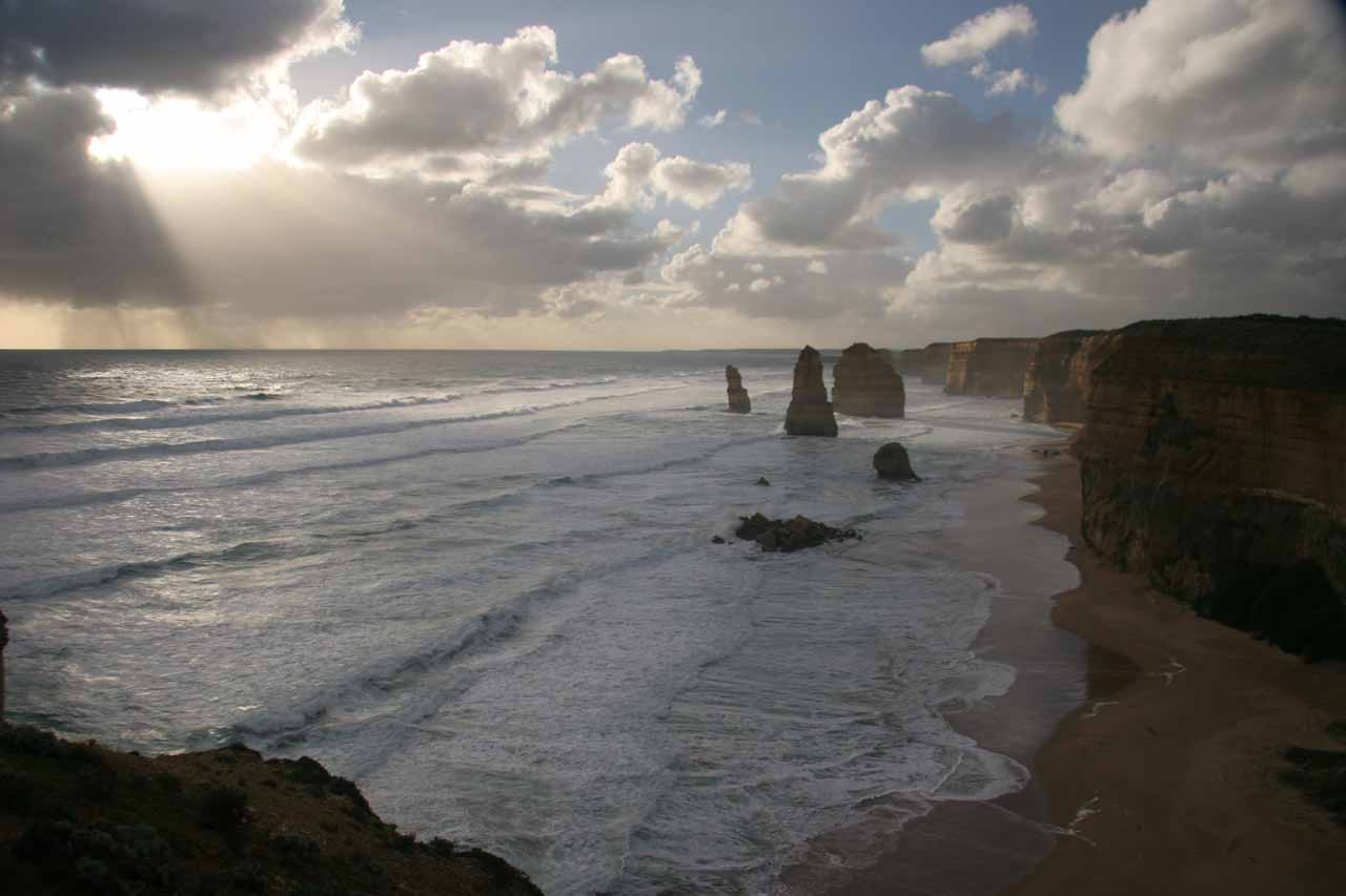 The Twelve Apostles with sun beams shining towards them