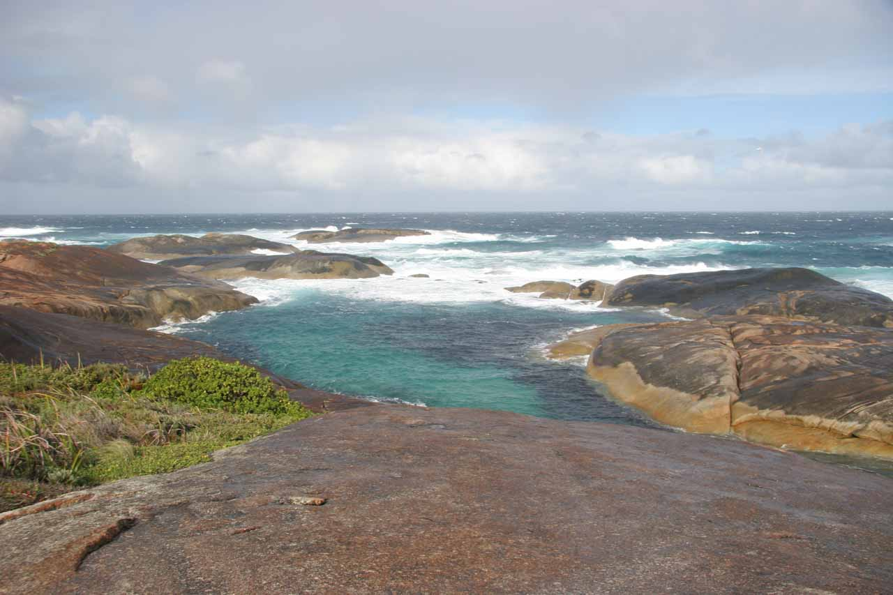 The Southern Ocean with waves breaking and leading to some pools by the Elephant Rocks