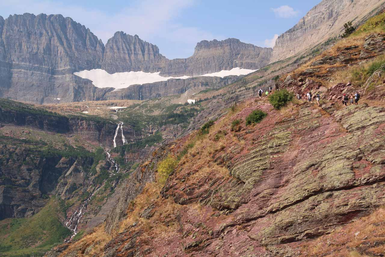 Context of the cliff-hugging Grinnell Glacier Trail and the Grinnell Falls in the distance