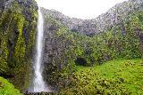 Grundarfoss_079_08172021 - Broad look at Grundarfoss with alcoves and mossy cliffs around it