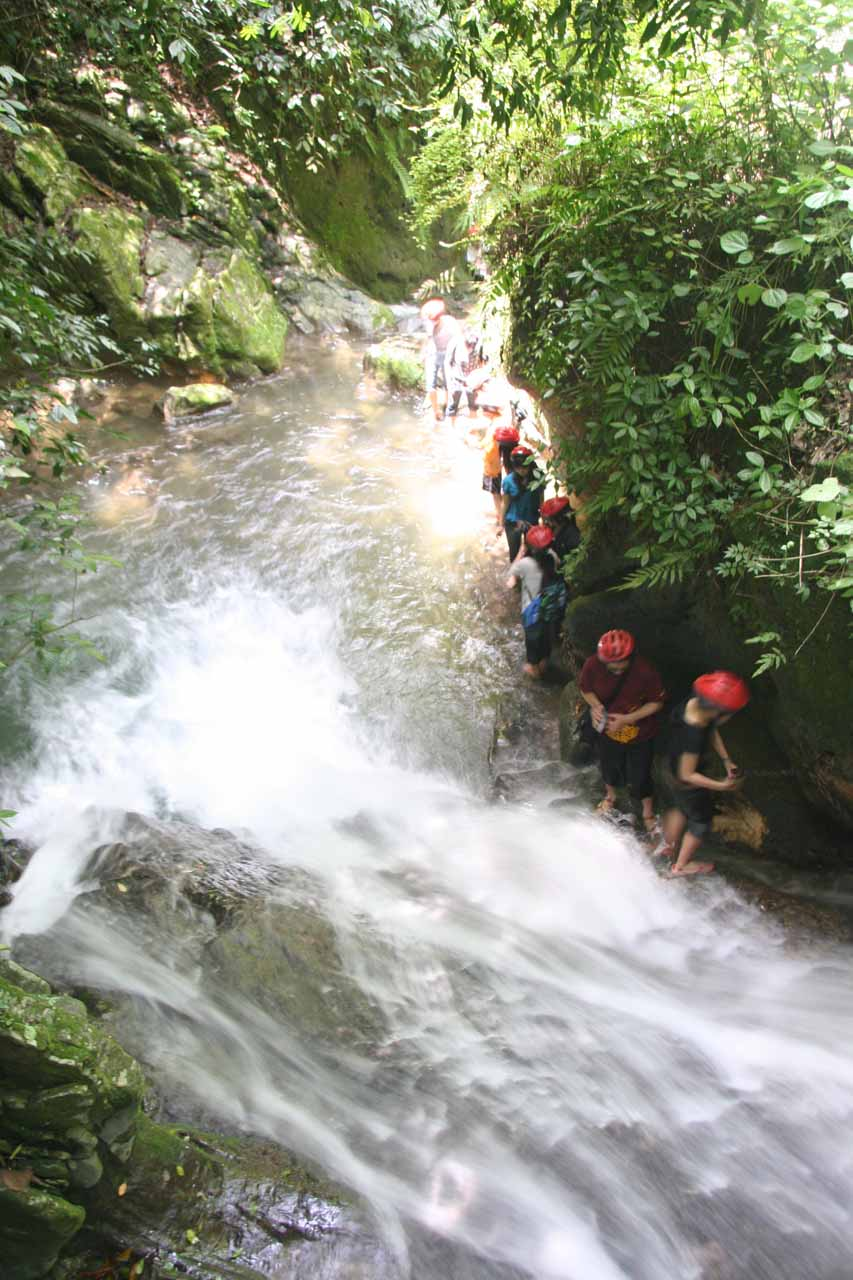 A line of climbers waiting to go up the next waterfall