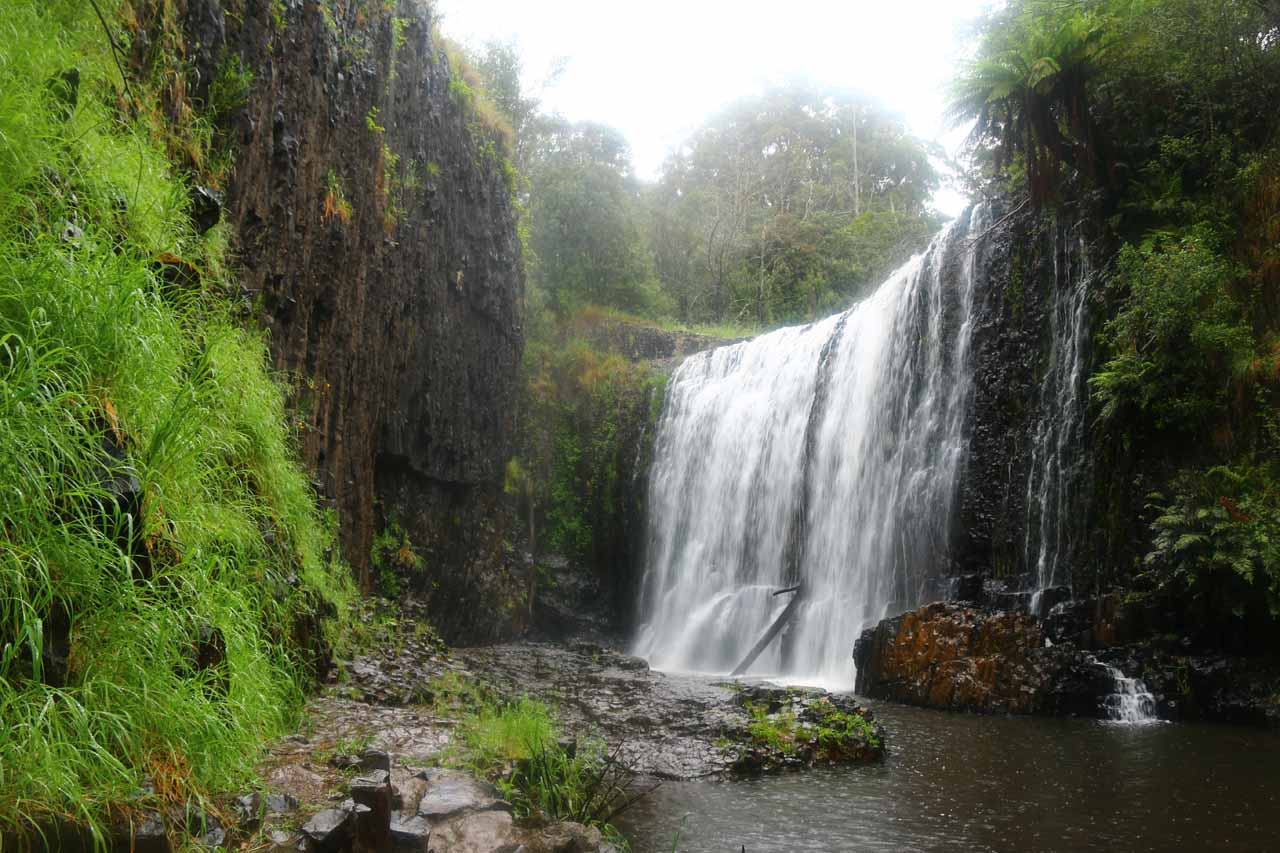 Guide Falls as seen from its base surrounded by dark columnar cliffs of basalt