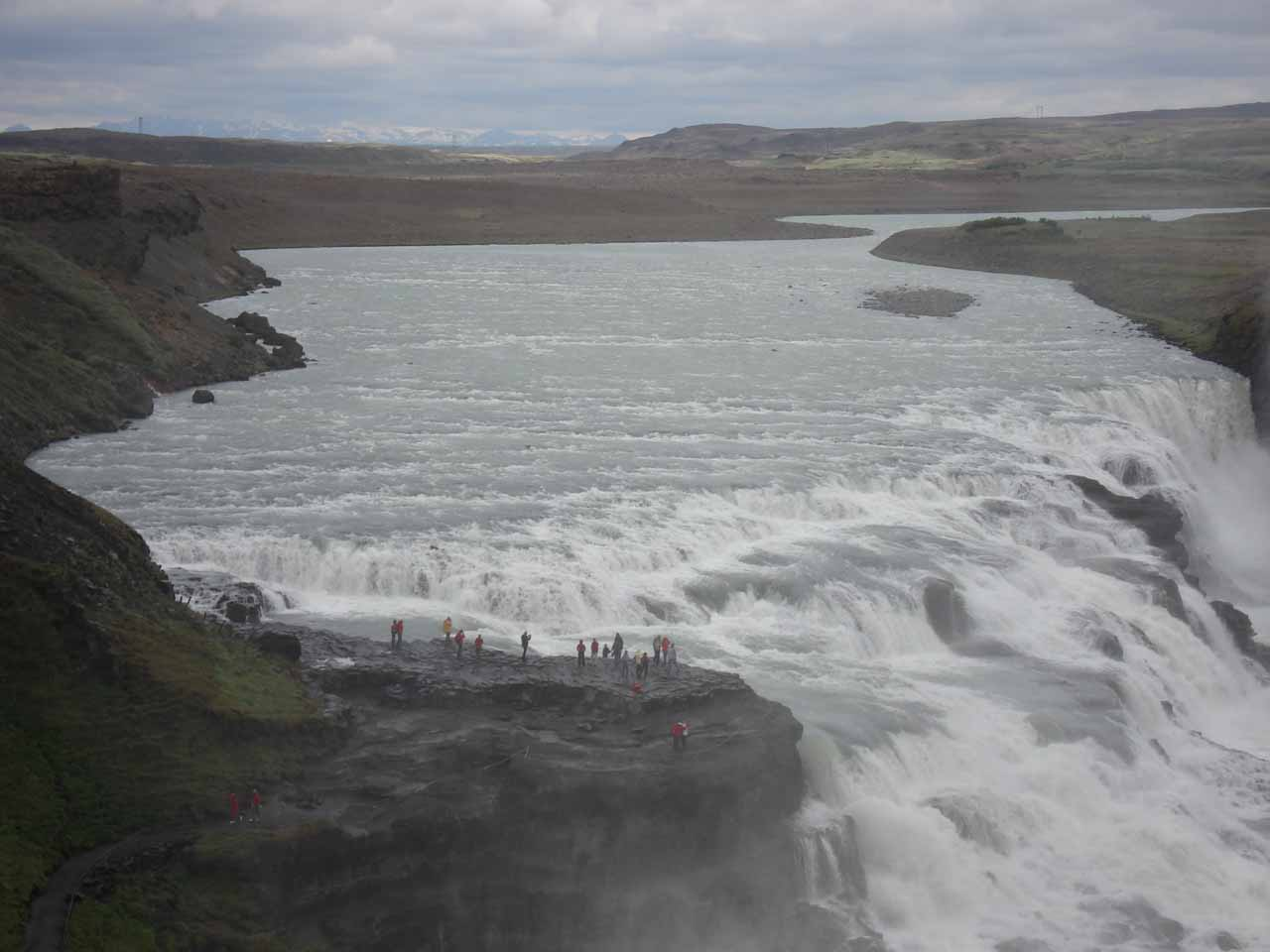 Looking upstream above the brink of Gullfoss with many onlookers
