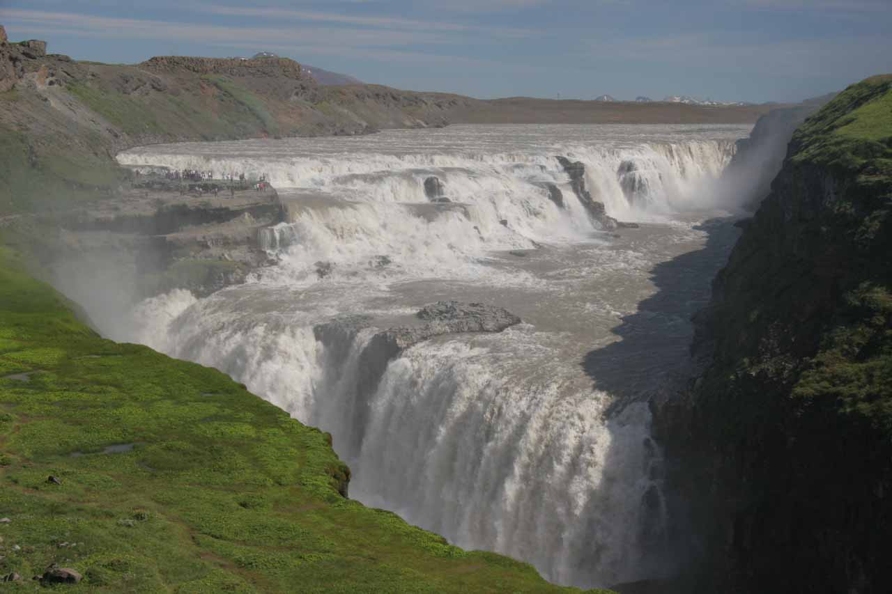 Midday view of Gullfoss from the lower car park under clear skies