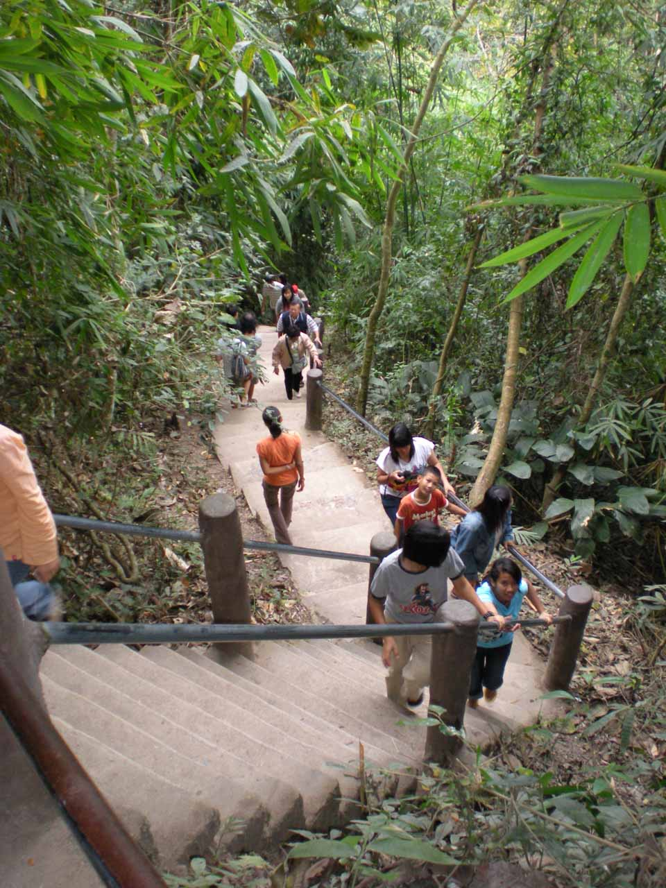 Embarking on the short but crowded trail leading to the base of the Haew Suwat Waterfall