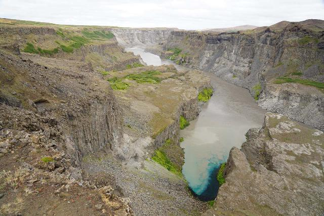 Hafragilsfoss_West_053_08132021 - Looking down at the mix of clear spring water mixing with the milky Jökulsá á Fjöllum within the scenic Hafragil Gorge section of Jökulsárgljúfur Canyon