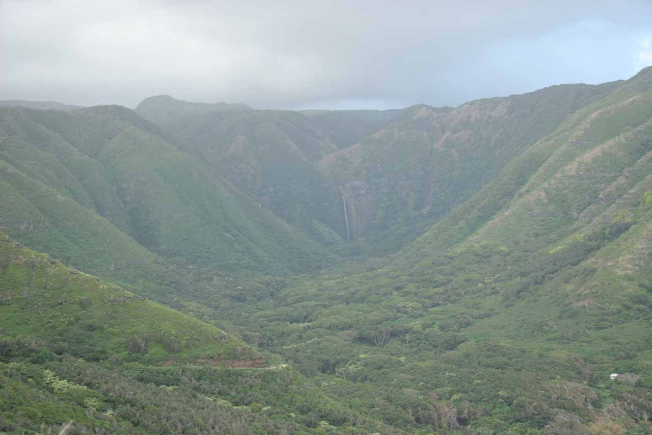 Looking into Halawa Valley backed by the tall Hipuapua Falls in the distance