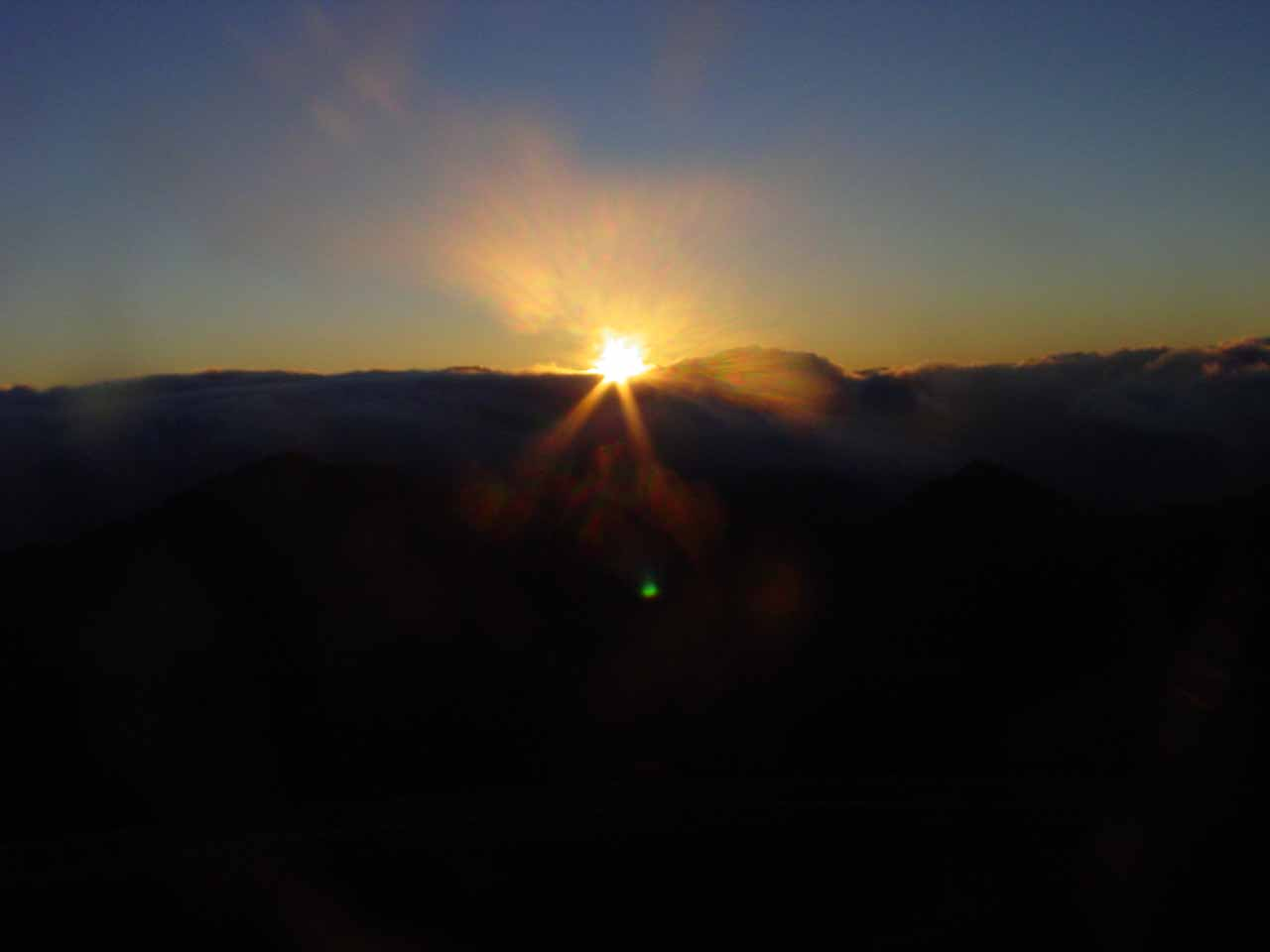 Sunrise over the clouds atop Haleakala