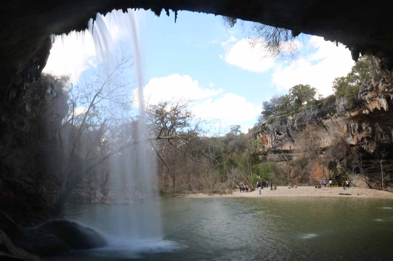 Looking out from behind the Hamilton Pool Waterfall