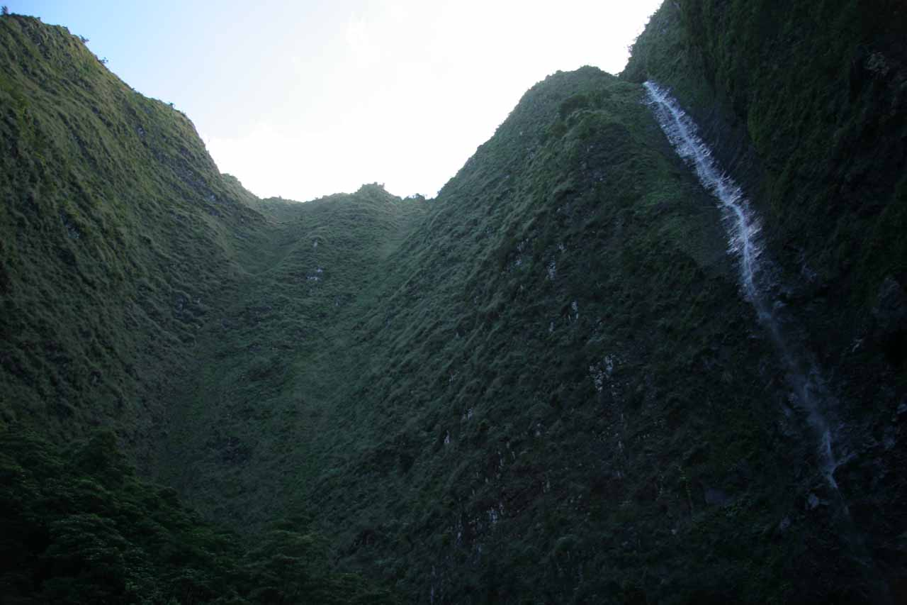 Surrounded by towering cliffs at the Hanakoa Falls