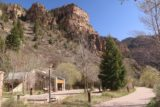 Hanging_Lake_009_04182017 - Looking past the restrooms towards some tall cliffs towering over the man-made Hanging Lake and parking area