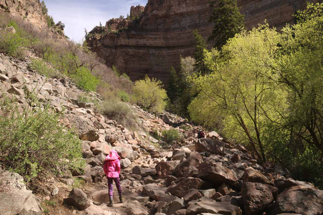 Tahia starting the long ascent up to Hanging Lake as she was traversing this large boulder field