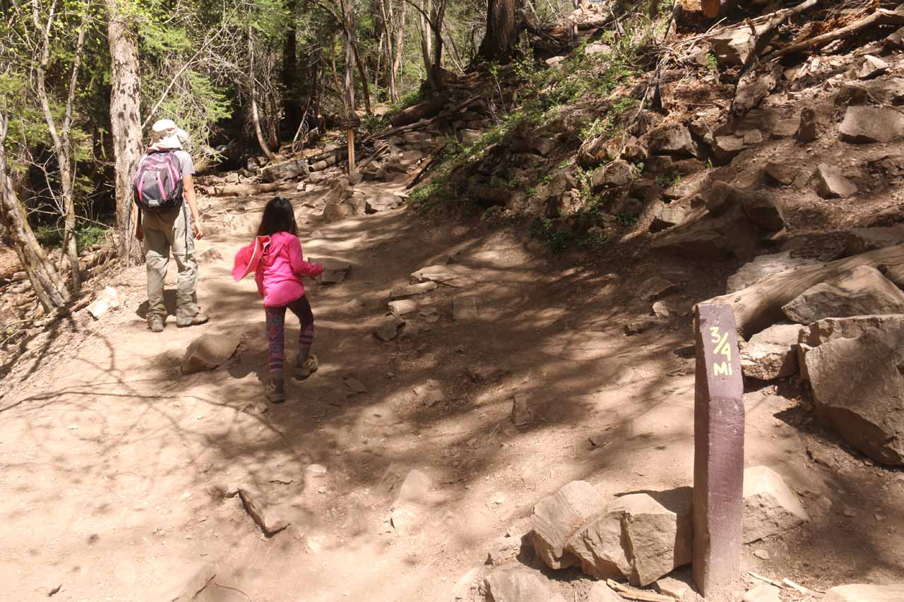 Julie and Tahia going past the 3/4-mile post, which was at the top of a series of switchbacks