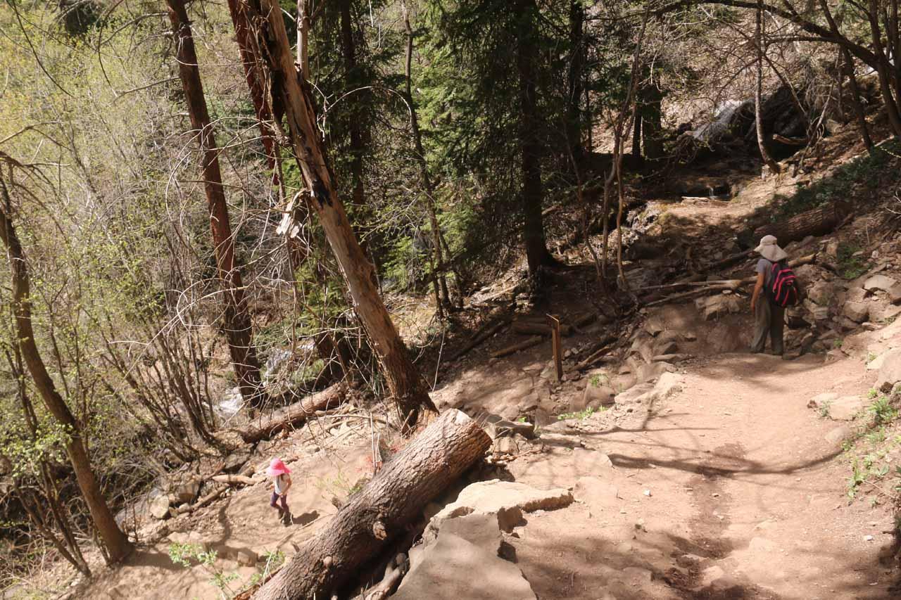 Tahia and Julie descending switchbacks on the return hike along Hanging Lake Trail
