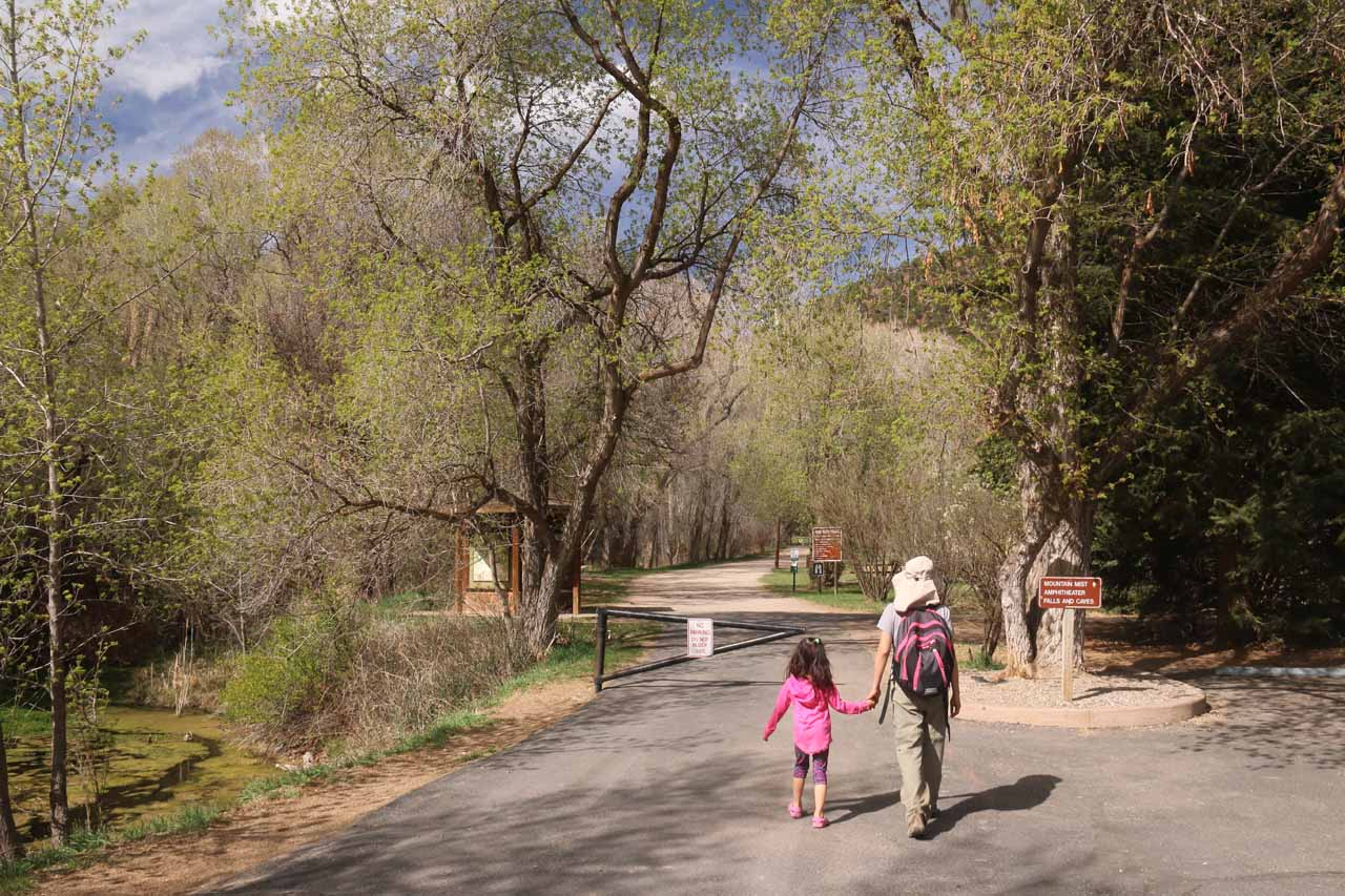 Julie and Tahia walking past the gate and onto the short paved path to Rifle Falls